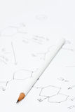 Pencil on paper with chemical formula Stock Photo