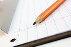 Pencil, paper and clipboard Stock Photo
