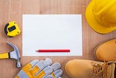 Pencil paper helmet boots gloves hammer tapeline Stock Photos