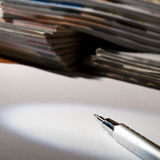 Pencil, paper and magazines Stock Image
