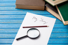 Pencil and paper with My Story words and books stock photography