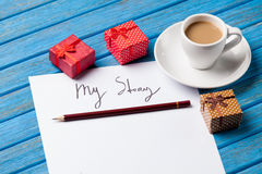 Pencil and paper with My Story words near cup Royalty Free Stock Photos