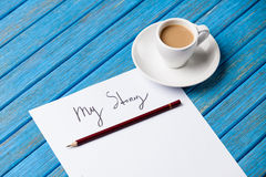 Pencil and paper with My Story words near cup of coffee Stock Image