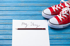 Pencil and paper with My Story words near gumshoes Stock Photos