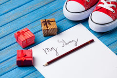 Pencil and paper with My Story words near gumshoes Royalty Free Stock Photo