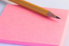Pencil and a paper note up close. Simple pencil and paper note. Royalty Free Stock Images