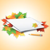 Pencil by the paper sheets with autumn maple leaves. Royalty Free Stock Photos