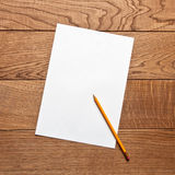 Pencil and paper on the table Stock Image