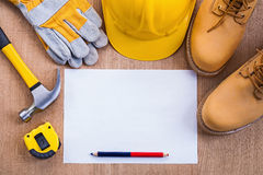 Pencil and paper tapeline hammer working boots Royalty Free Stock Image