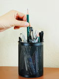 Pencil and pen container. In office, each kind of pen and pen container on desk Royalty Free Stock Photography