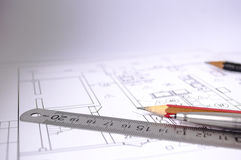 A pencil and pen on the layout of a building Royalty Free Stock Image