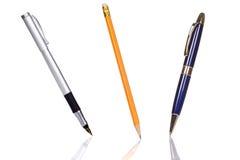 Pencil and pen on white Stock Photos