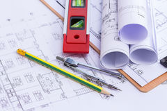 Pencil and pencil compasses over a construction plan Royalty Free Stock Images