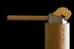 Pencil and pencil sharpened. Pencil in pencil sharpened on black ground Royalty Free Stock Photography