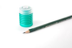 Pencil with a pencil sharpener. A pencil sharpener and a pecil isolated on a white background Royalty Free Stock Photography
