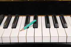 Pencil and piano Stock Photos