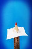 Pencil pierced the sheet of paper. Pencil pierced the sheet of paper on a blue background Royalty Free Stock Photos