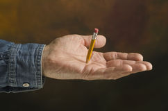 Pencil piercing hand Royalty Free Stock Images