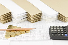 Pencil on pile of gold coins with calculator Royalty Free Stock Photos