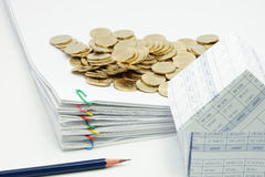 Pencil and pile overload document of report with colorful paperclip. With house and pile of gold coins on white background Stock Photography