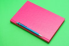 Pencil and pink book Royalty Free Stock Photo