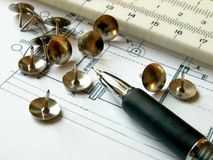 Pencil and pins. Photo of pencil and pins on technical draw Stock Image
