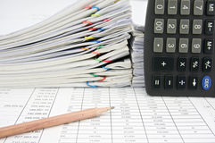 Pencil place on finance account with calculator Stock Photos