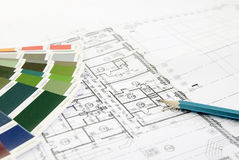 Pencil on the plan. The building drawing on which lies a pencil and a colour palette Stock Image