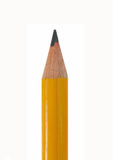 Pencil Point. Closeup of the sharpened tip of a yellow lead pencil Stock Photo