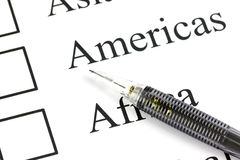 The pencil point to Checkbox in Americas text. Royalty Free Stock Images
