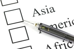 The pencil point to Checkbox in Asia text. Royalty Free Stock Image