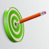 Pencil pointed to center of target Stock Photo