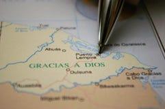Pencil pointing at a Honduras City Gracias a Dios. Amo a pencil pointing yo a city called Puerto Lempiira Stock Images