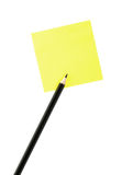 Pencil and post-it. Pencil and yellow post-it, isolated on the white Royalty Free Stock Photos