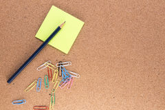 Pencil, post it notes and paper clips Royalty Free Stock Photography