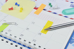 Pencil with post It notes and pin on business diary page Stock Photography