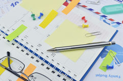 Pencil with post It notes and pin on business diary page Royalty Free Stock Photo
