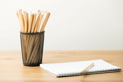Pencil in pot with notebook Royalty Free Stock Photo