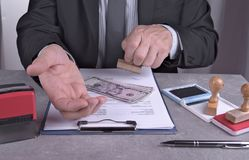Pencil pusher asking for a bribe in euros or in dollars. Royalty Free Stock Image