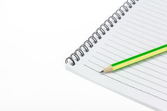 Pencil put on Paper note book. Royalty Free Stock Photography