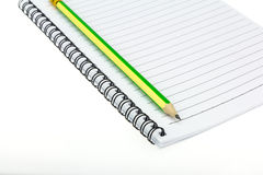 Pencil put on Paper note book. Pencil put on Paper note book  on white background Stock Images