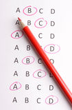 Pencil with questionnaire. A questionnaire with a red pencil Royalty Free Stock Photo