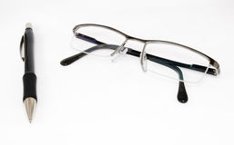 A pencil and reading glasses Stock Photo