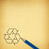 Pencil & recycle symbol on brown paper for texture background Stock Photography