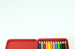 Pencil in red metal box isolated Stock Photos