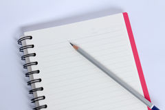 Pencil with red notebook on white table Stock Photo