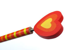 Pencil with red and yellow heart of love Royalty Free Stock Photos