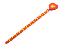 Pencil with red and yellow heart of love Stock Images