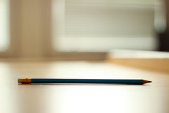 Pencil with rubber. On desk Royalty Free Stock Photo