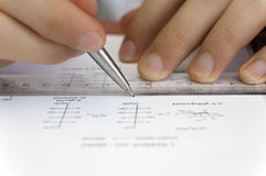 Pencil and Ruler. With hands and paper royalty free stock image